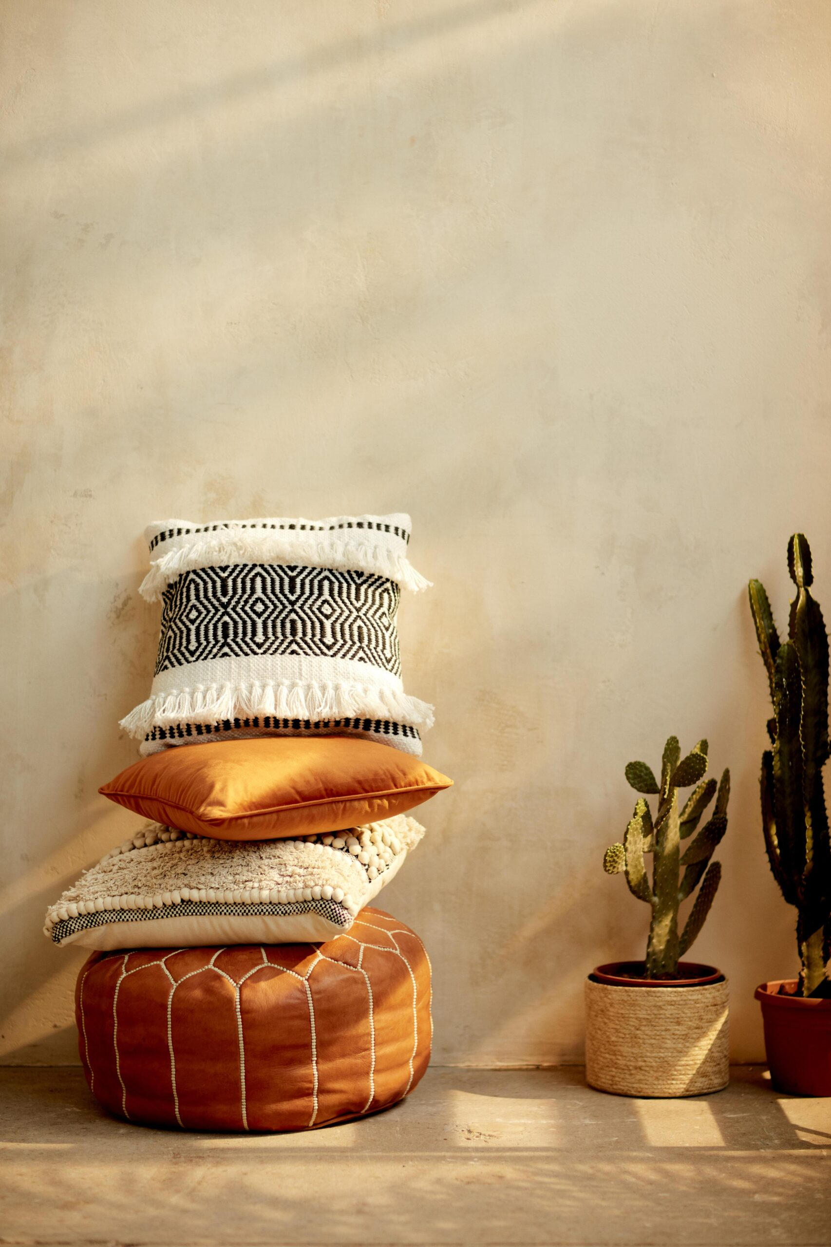 Cushions from Primark piled on a pouffe