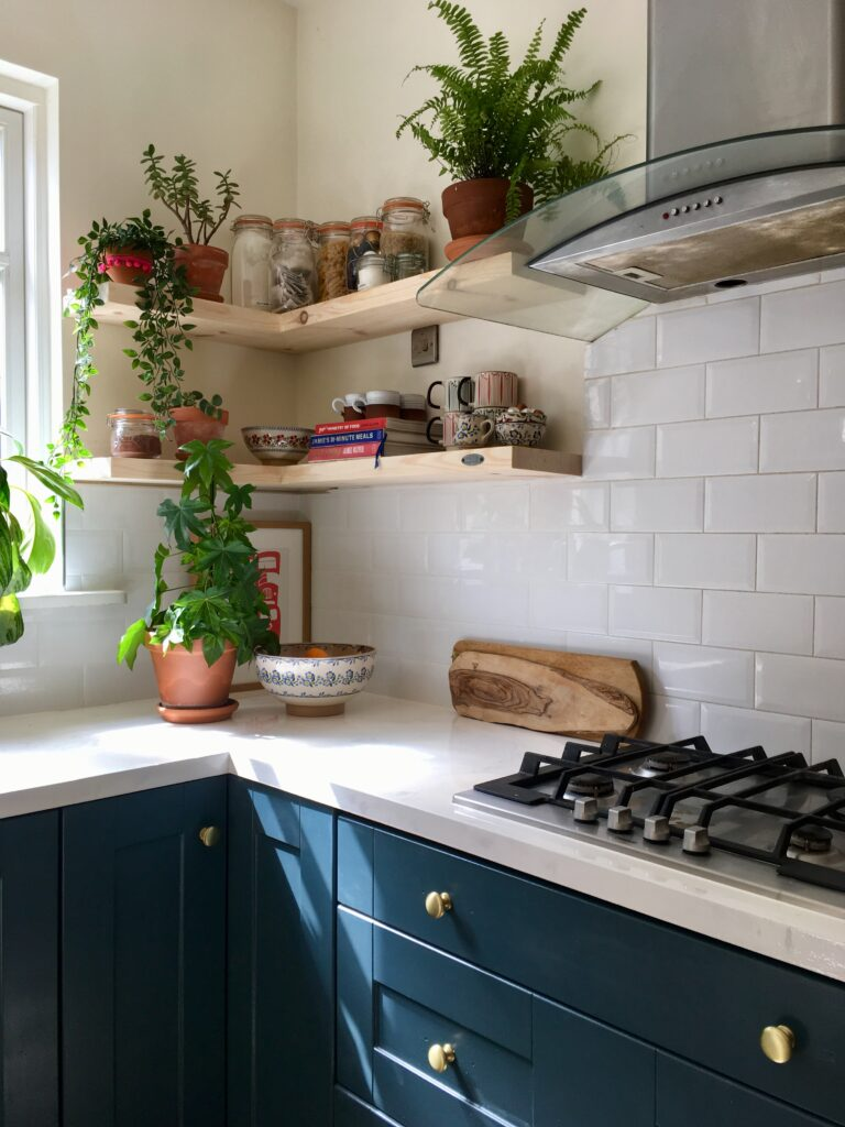Navy kitchen with white countertops