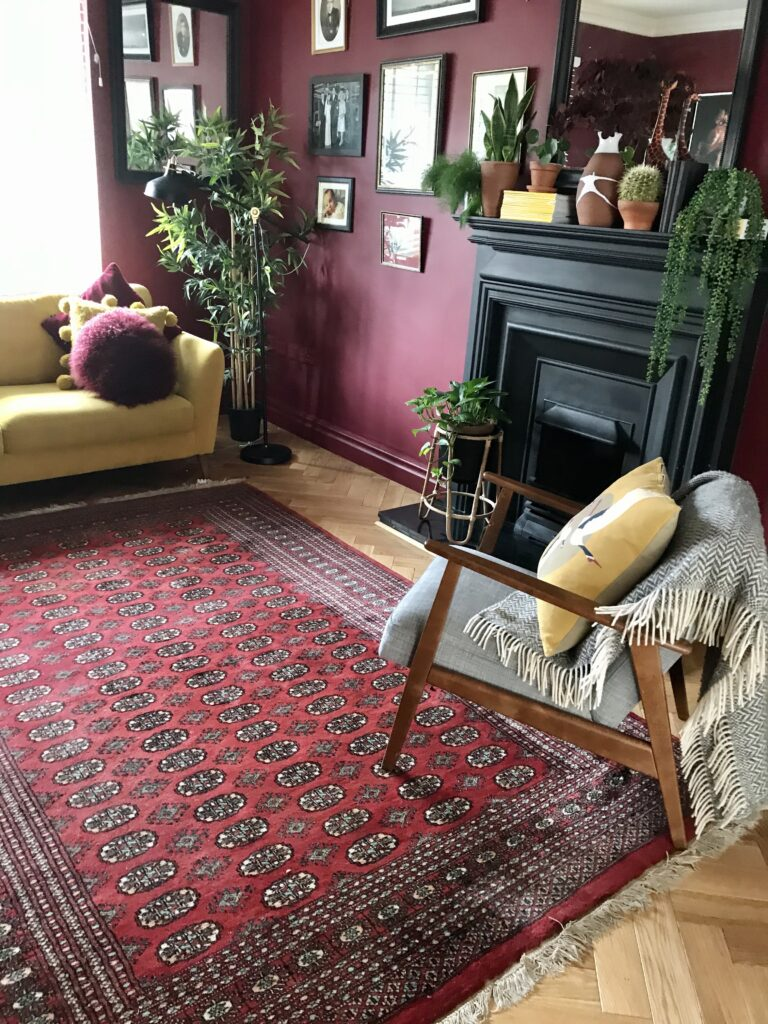 Wine coloured persian style rug