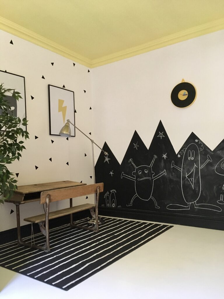 Chalk wall and old school bench in kid's room