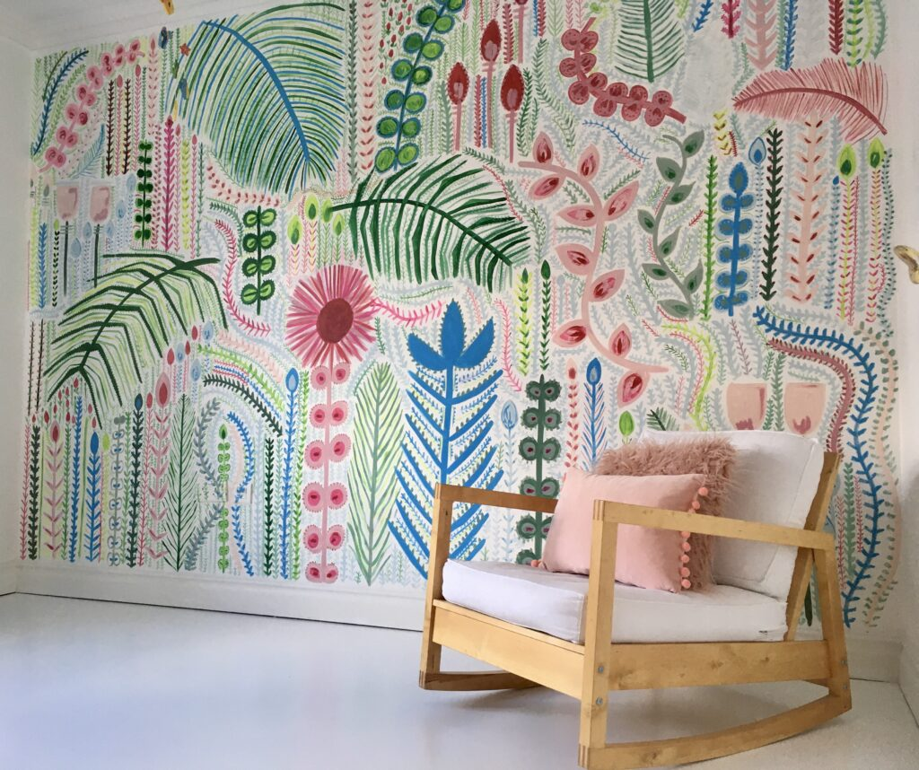 Hand painted green, blue, and pink wall mural