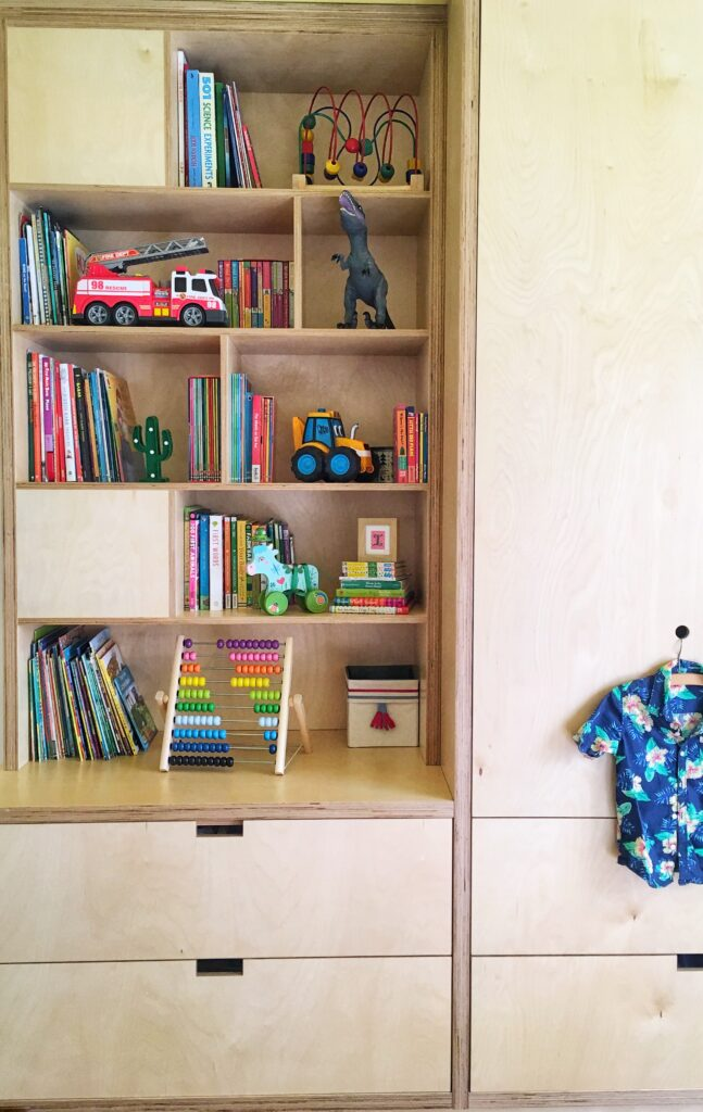 Toys and books in kid's bedroom wardrobe