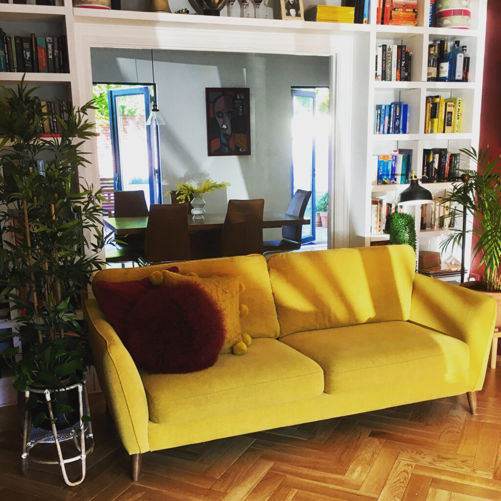 Mustard sofa with wine and mustard cushions