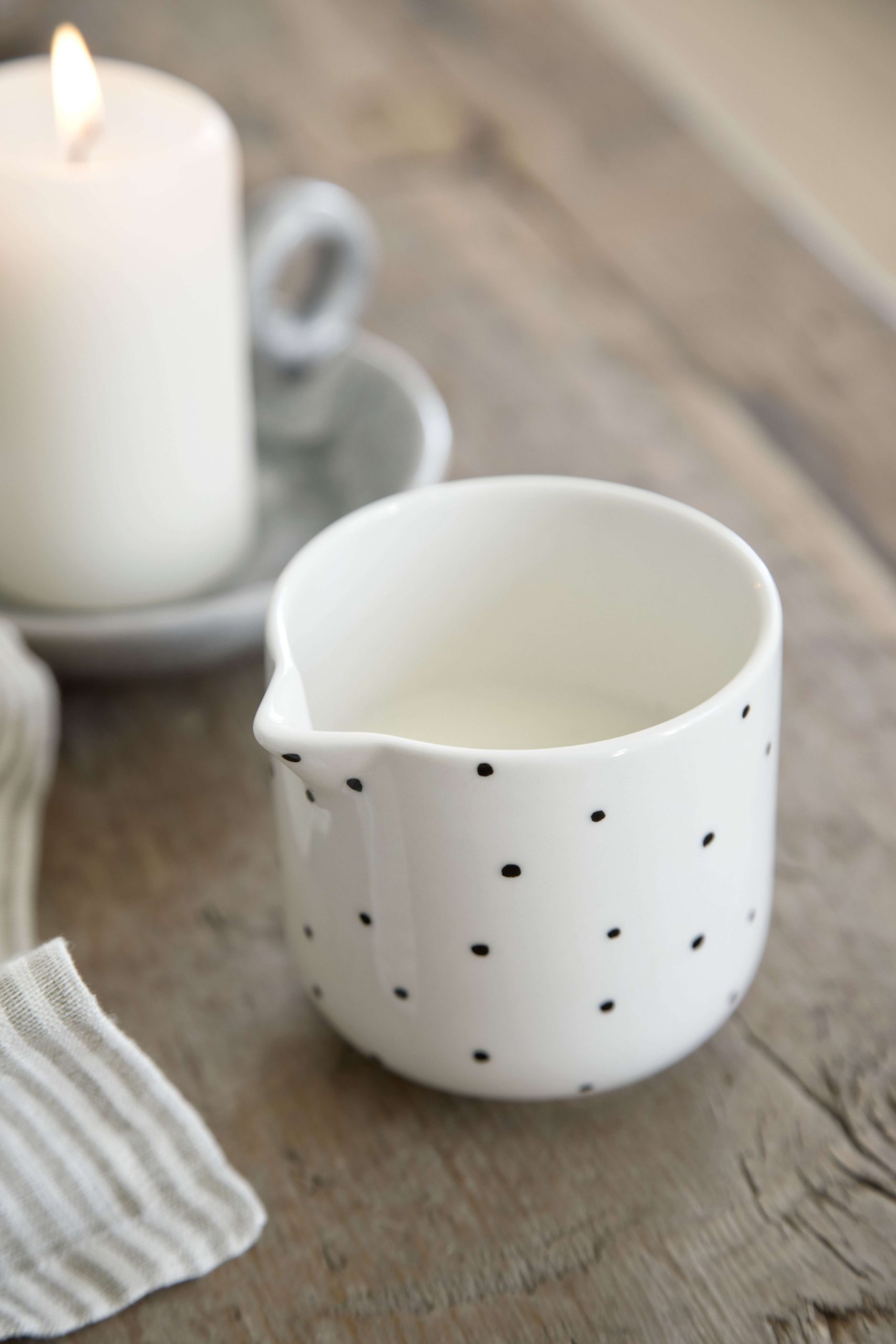 white milk jug with black dots