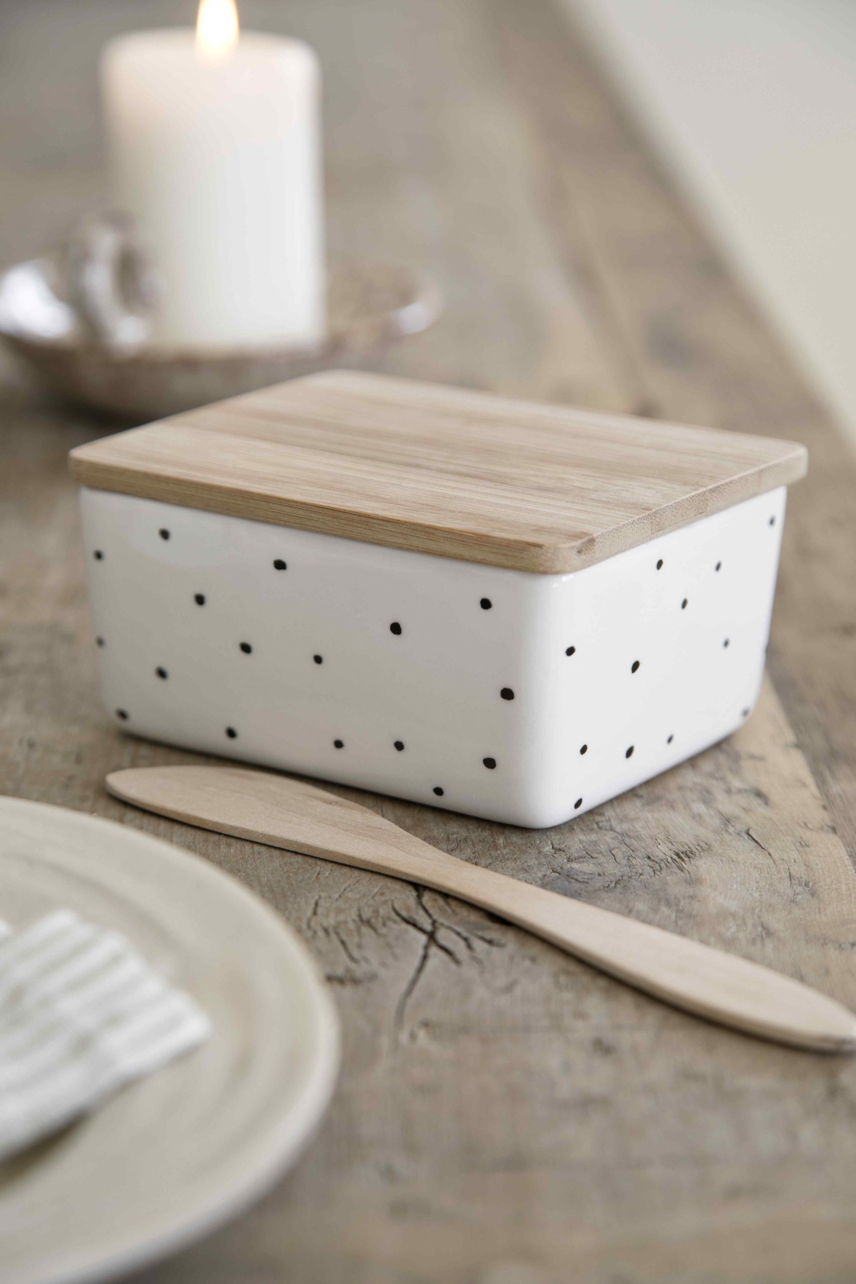 white butter dish with black dots